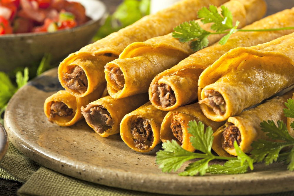 Homemade Mexican Beef Taquitos with Cilantro and Salsa