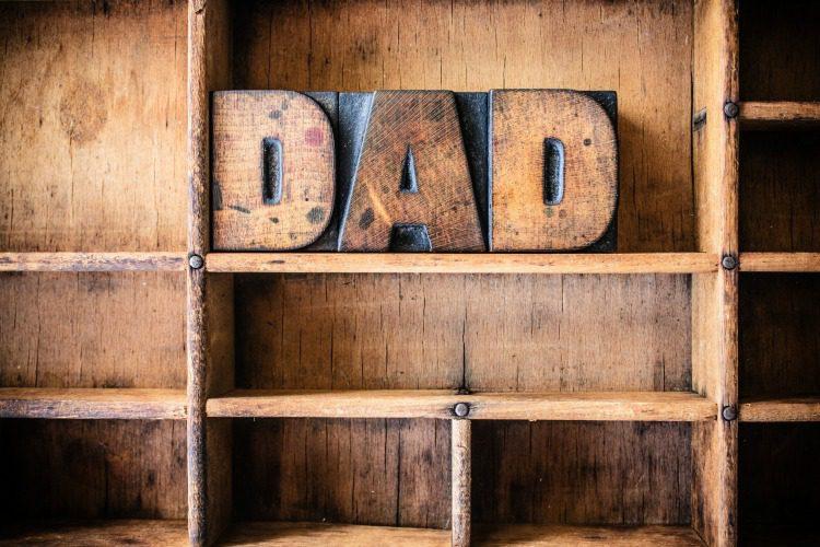 The word DAD written in vintage wooden letterpress type in a wooden type drawer.