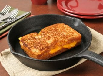 A grilled cheese sandwich in a cast iron skillet