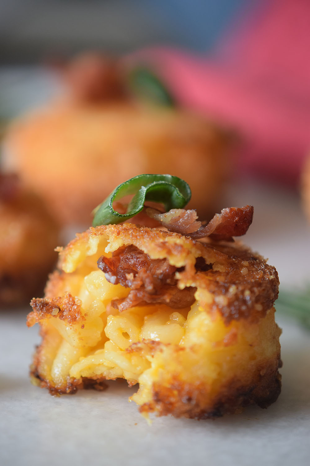 Fried mac and cheese with bacon in the center