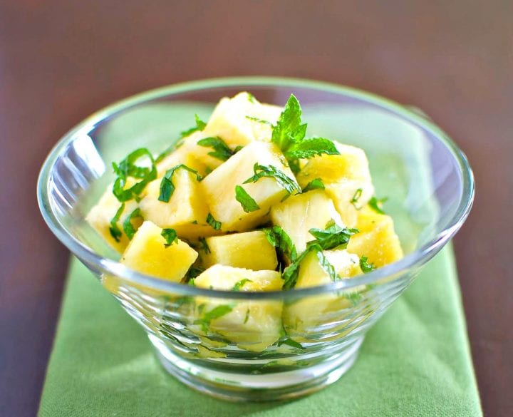 Pineapple salad in glass dish.