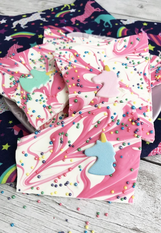 Pink and white swirled unicorn bark with sprinkles.