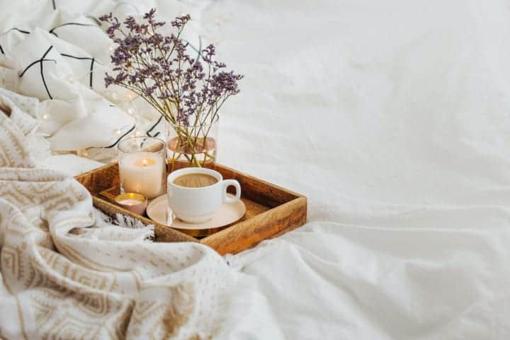 flowers candle coffee wood tray on bed